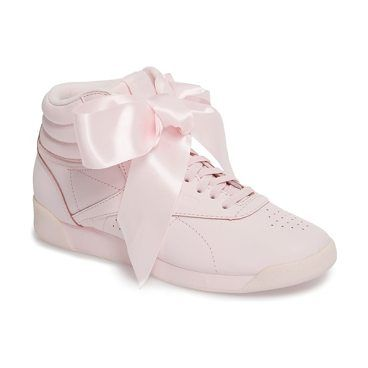 freestyle hi satin bow sneaker by Reebok. A statement-scale satin bow adds a fun finish to the front of a high-top sneaker styled for lightweight comfort with a generously cushioned interior lined in soft terry. Style Name: Reebok Freestyle Hi Satin Bow Sneaker (Women). Style Nu... #reebok #sneakers #activewear #athleisure