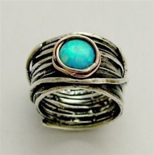 sterling silver, rose gold, opal. eye of ocean ring