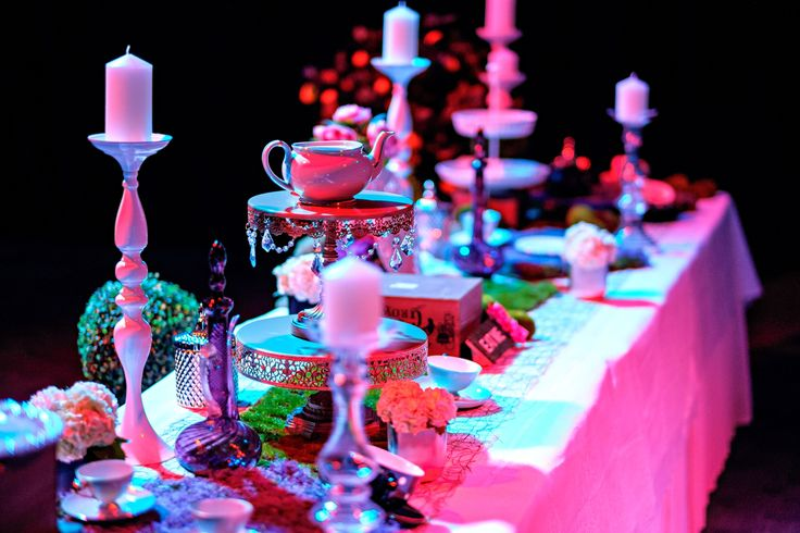 Our Alice in Wonderland tea party table set and ready for dessert. An assortment of new and antique treasures. Photo by Jon Jarvela