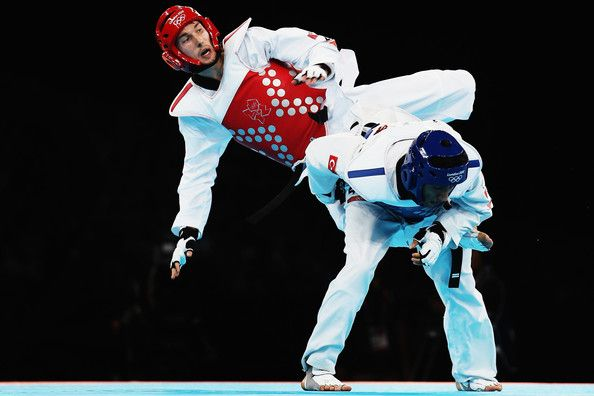 Martin Stamper Photos Photos - Martin Stamper of Great Britain competes against Servet Tazegul of Turkey during the Men's -68kg Taekwondo semifinal match on Day 13 of the London 2012 Olympic Games at ExCeL on August 9, 2012 in London, England. - Olympics Day 13 - Taekwondo