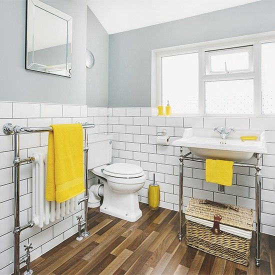 white and grey bathroom with yellow accents and faux wood flooring