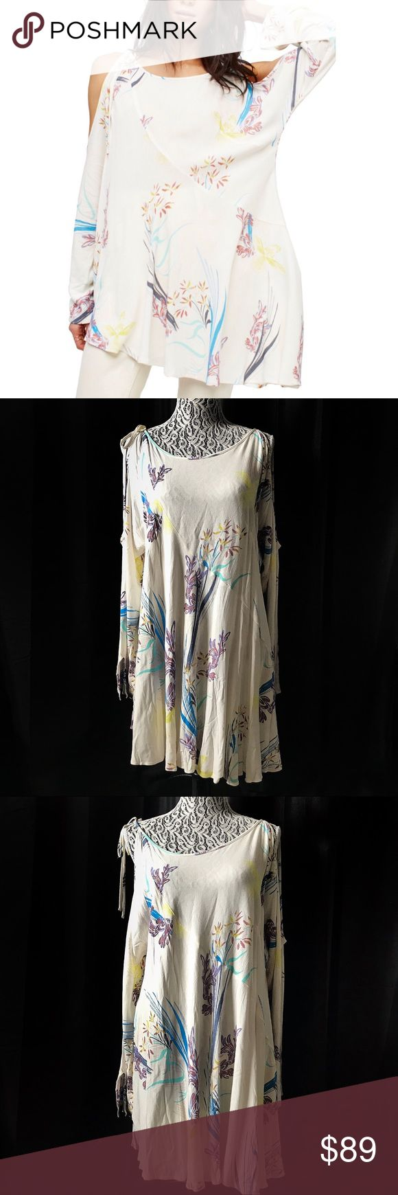 """Free People clear skies cold shoulder tunic small Free People clear skies cold shoulder tunic small  Pit to pit 22"""" Raglan sleeve 28"""" Shoulder 12"""" Length 33""""   Not what you're looking for? Feel free to browse my closet for other occasions: Winter, spring, summer, fall, birthday, New Year's Eve, Valentine's Day date, Graduation, Prom, Purim, St. Patrick's Day, Easter, Earth Day, Cinco de Mayo, Mother's Day, EDC, Coachella, Memorial Day, Comic Con, 4th of July, Labor Day, Thanksgiving…"""