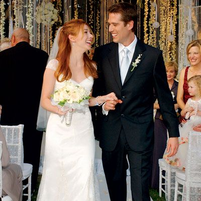I do love Alyson Hannigan of Buffy fame, but I really love those hanging strands of flowers and beads as a wedding backdrop. Truly enchanting!