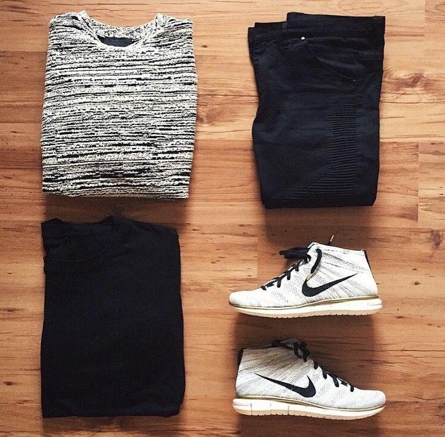 heather grey sweater. black tee. dark blue / black jeans. heather grey / white sneakers.