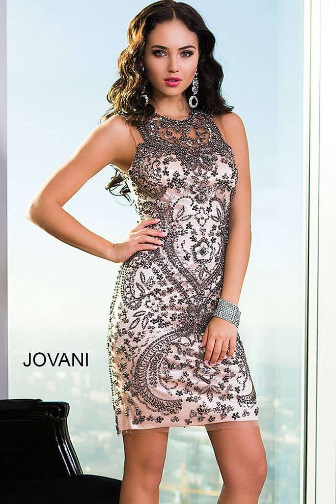 Sleeveless gunmetal and nude cocktail dress features crystal and beaded embellishments, a sheer neckline, an open back and a zipper in the back.