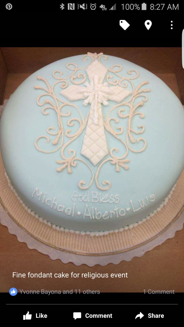 Religious round cake for a boy in light blue rolled fondant with white tiled cross and beige buttercream arabesque with God bless you in white