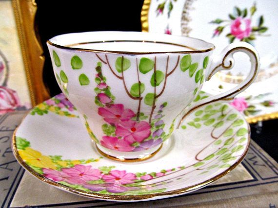 OFFERING THIS FANTASTIC TEA CUP AND SAUCER MADE OF A FINE BONE CHINA WITH NO CRAZING AND NO CHIPS NO HAIRLINES AND IT IS A BEAUTY PAINTED AND BEADED POINTS ON THE FLOWERS TRIMMED IN GOLD AND MADE BY ROYAL STANDARD FINE BONE CHINA NO WEAR AND NO FADING AND NO CRAZING MADE AROUND THE