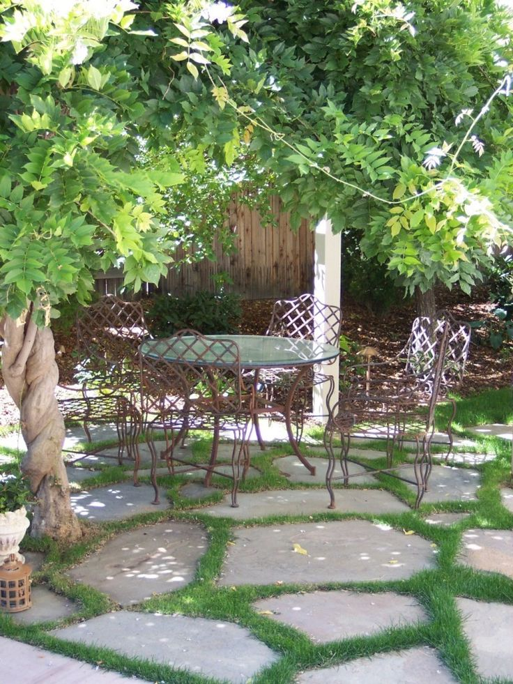 ... Set Of Vintage Wrought Iron Dining Table And Chairs On Bronze Look  Paint Colours Above Flagstone Pavers With Grass In Between From Backyard  Patio Ideas