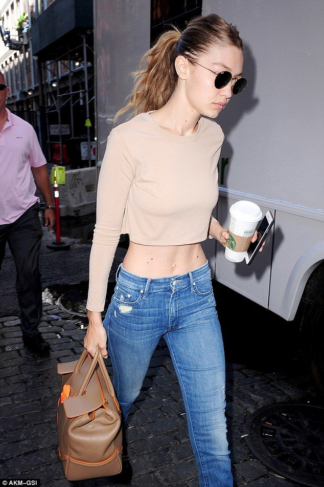 Early call time:Earlier the sister of Bella - also a model - was seen with head down as she headed into the shoot.Gigi was carrying a Starbucks coffee and her cell phone