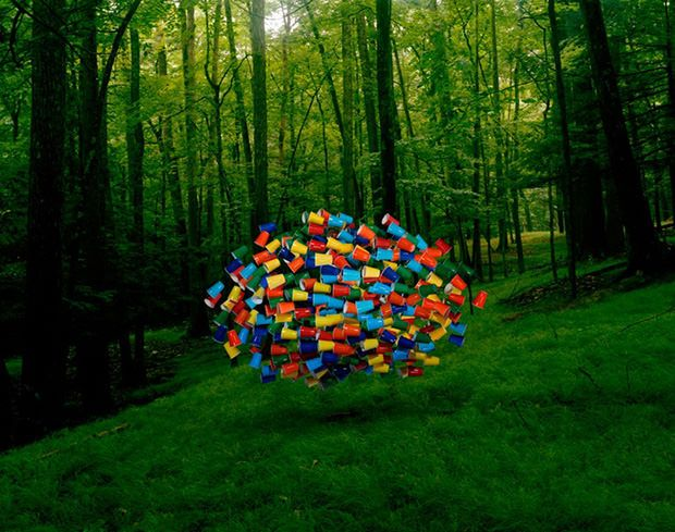 Photographer Thomas Jackson has an ongoing project titled Emergent Behavior that consists of surreal photographs of swarms of various things.  http://www.thomasjacksonphotography.com/Page%2074.htm