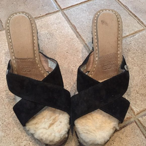 Ugg shoes These have been worn but still so cute and who doesn't love an Ugg shoe. The the white padding is worn down and marks on the heel and area to the fur. The black suede could use a cleaning. If you are looking for Uggs for a low price then you will love these. UGG Shoes