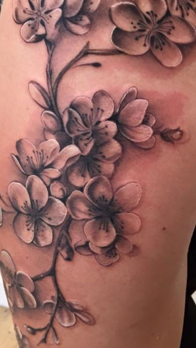 Cherry blossom on thigh in black and grey – by Nic…