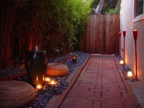 Plantless pathway, the stones and tiki torch lighting is a nice idea. The fence rounds it out