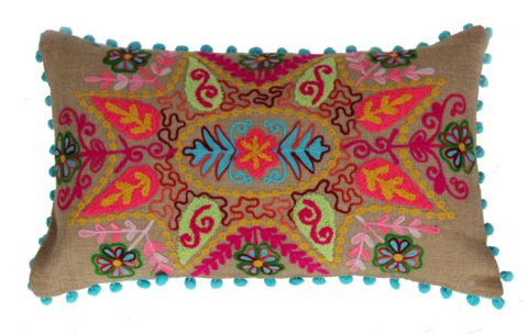 A gorgeous, happy cushion full of lively colour and glorious pattern, with a fun bobble trim.  Chain stitch detail on a natural jute backing.  Handmade in India.  Includes New Zealand made polyfill inner.  Dimensions: 30x50cm