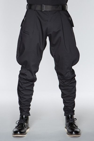 Visions of the Future: ACRONYM GmbH — P13-CH: A sculpted, three dimensionally patterned pant derived from traditional military and riding jodhpurs. Cut with the Acronym® DFMA high reach gusset and articulated knees, P13 offers no resistance to moves in virtually any direction. The separating 5mm reverse coil zip cuffs can be worn open, or zipped shut to various heights for variable shaping of the lower leg.