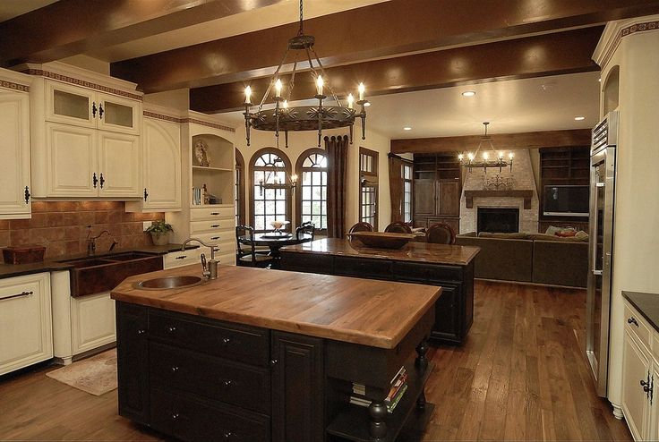 Eclectic Kitchen with U-shaped, Chandelier, Built-in bookshelf, Raised panel, 1920 spanish torch round chandelier, Stone Tile