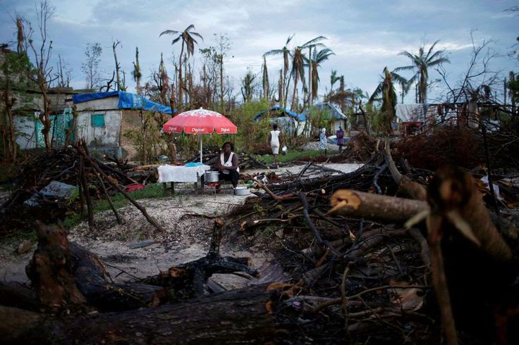 Pictures of the Year 2016:     Weather:     A food vendor waits for customers after Hurricane Matthew hit Jeremie, Haiti, October 18, 2016.