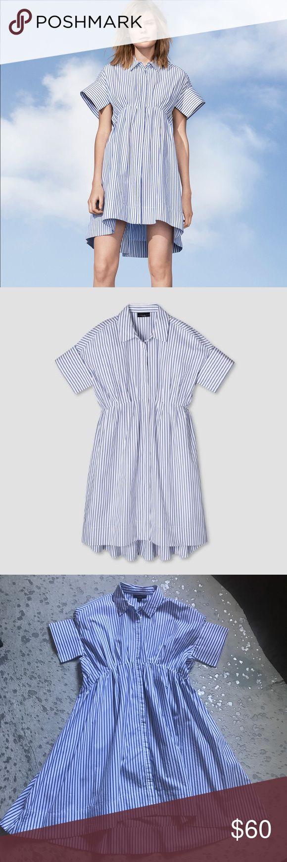 Victoria Beckham target dress Victoria Beckham for target dress. Blue and white pin stripe. Hidden button up. Very flattering. Excellent condition. 100% cotton Victoria Beckham for Target Dresses