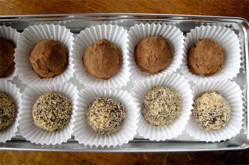 Melt-In-Your-Mouth Dark Chocolate Coconut Oil Truffles  Servings: 18-25 Preparation Time: 25 minutes      6 oz. (1/2 12 oz. bag) semi-sweet chocolate chips     6 oz. (1/2 12 oz. bag) bittersweet chocolate chips     6 tablespoons organic virgin coconut oil     4 tablespoons water     1 teaspoon vanilla (other options: 1 teaspoon grand marnier, brandy, rum, amaretto, or 1/2 teaspoon almond extract)     pinch of salt