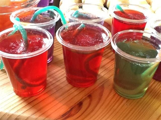 Fill plastic shooter glasses with jello and some jelly snakes- this serves a large group of children and still looks horribly scary https://www.youtube.com/watch?v=jIqqMAMqbK8