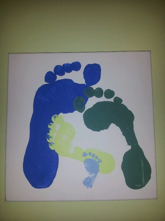 Mom, dad, sister, and newborn brother foot prints