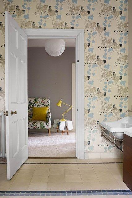 Children's bathroom with chicken wallpaper in Bathroom Design Ideas. Large childrens' bathroom with wallpaper, limestone tiled floors, steel vanity and Victorian radiator.