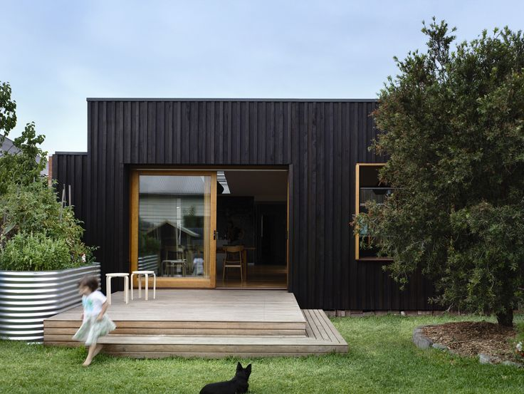 """Radial timber vertical battens in Cutek """"Black Ash"""" finish. Application: Batten & Board House by Rob Kennon Architects. The door and window frames are made from kiln dried hardwood timber, Cutek clear finish. http://www.cutek.com.au/index.html"""