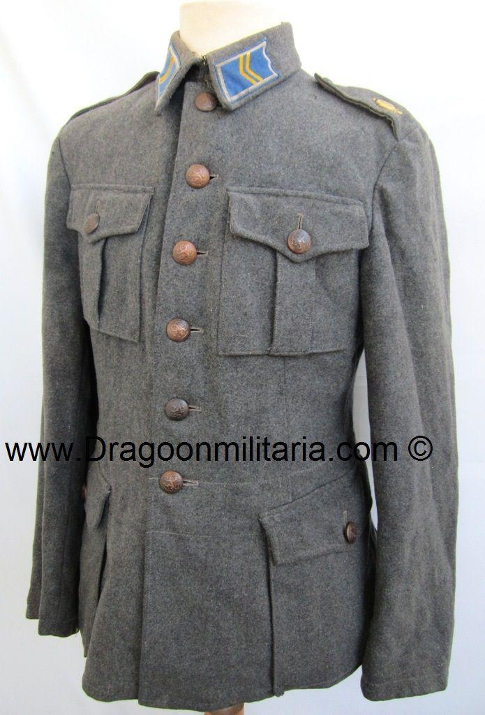 """Supply troops corporal. Supply collartabs (blue/grey) and supply troop emblems at shoulder straps. Grey wool  jacket. Marked B 50, Int41(1941) and maker """"Puku-keskus Oy"""". Dark colored copper metal buttons."""