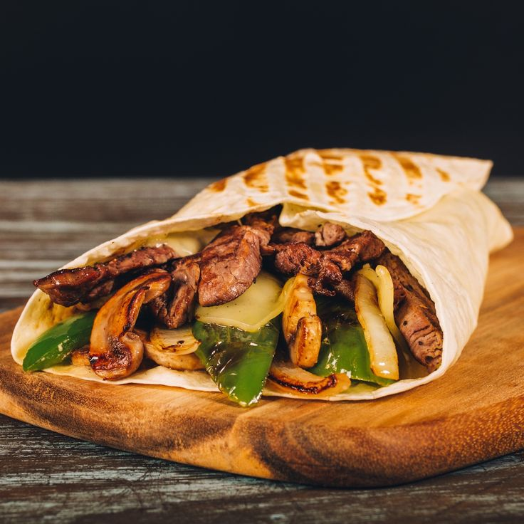 New special! Philly cheesesteak wrap with beef tenderloin, swiss cheese, grilled onion, mushrooms, green pepper and garlic mayonnaise