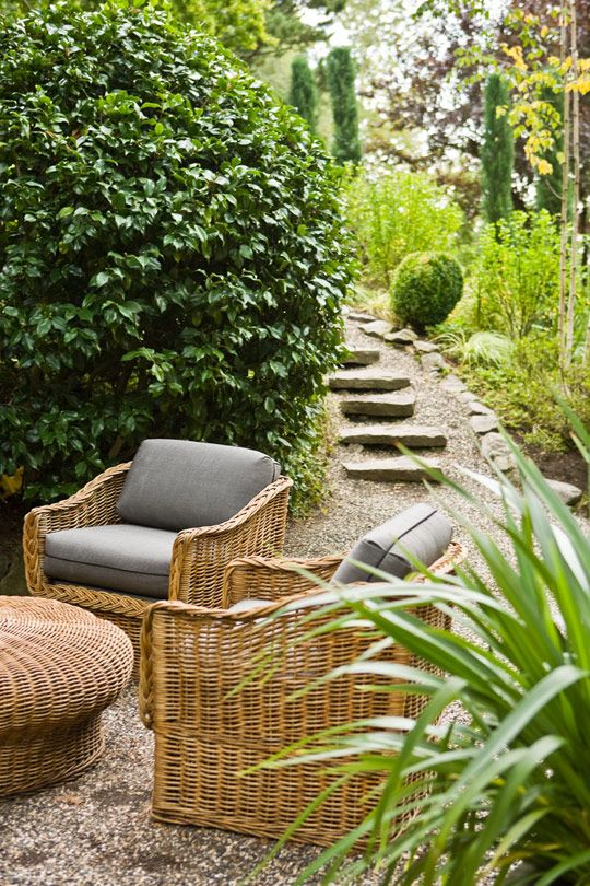Stepping stones leading to a sitting area. comfy wicker furniture.