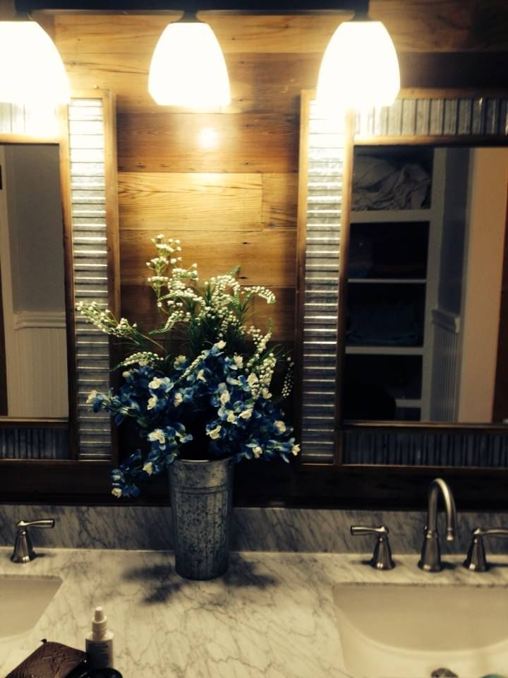 Master Bath used cedar boards stained in weathered oak. Found the mirrors online bamboo with metal insets.