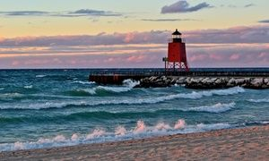Groupon - Stay at Charlevoix Inn & Suites in Charlevoix, MI, with Dates into October in Charlevoix, MI. Groupon deal price: $51.75