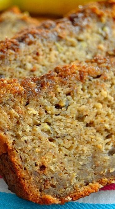 The BEST Banana Bread ~ super soft and tender. Perfectly spiced with cinnamon and a pinch of nutmeg, is jam-packed with fresh, sweet banana flavor, and is topped with an irresistible, crunchy brown sugar & cinnamon crust that lends a crispy crunch to every bite #healthy #banana #bread