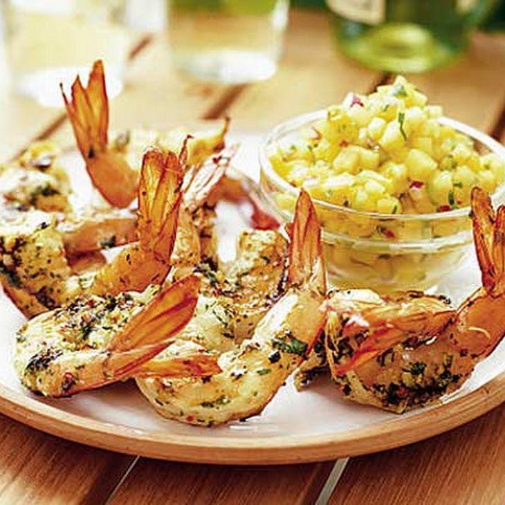 Fragrant Thai prawns Recipe with king prawns, shallots, garlic cloves, fresh red chili, fresh ginger root, lemongrass, fresh mint, cilantro leaves, olive oil, lime