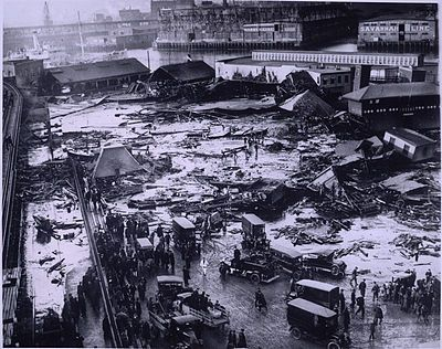In January 1919, a molasses tank of a Boston distillery suddenly exploded, unleashing a 35-foot tall wave of 2 million gallons of boiling hot molasses into the wintry city streets. It swept railroads, buildings, cars, carts, humans and animals into a vast pool of choking, sticky goo. 150 people were injured and 21 dead, and the harbor was a dark, sludgy brown all the way 'til summer. Folks still say that on certain days in Boston's South End, it smells strangely of pancakes....