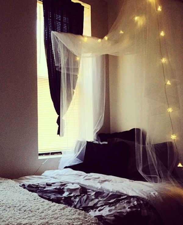 DIY canopy; looks like wire hung from the ceiling with fabric draped over - just add string lights for effect!