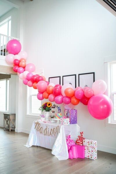 A super easy balloon garland DIY! Two inexpensive must have items to make your balloon garland stress free! Balloon garlands make any backdrop pop with dimension and color, and are my favorite things to put up for any party. #ballongarland #balloonarch #balloons #childrensparties #partydecor #babyshower #babyshowerdecor #birthdayparty #birthdaypartydecor #partydiy #diypartydecor #partyprep #girlypartydecor #babyshower