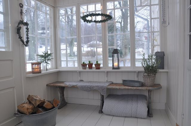 Inside a Scandinavian glassed porch at wintertime - Vita Verandan