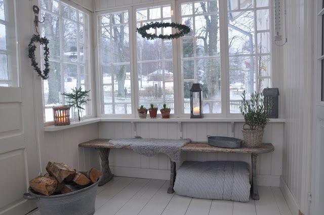 Inside a Scandinavian glassed porch at wintertime - Vita Verandan