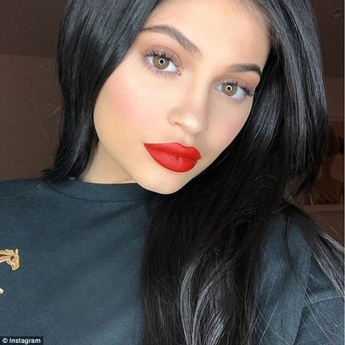 Red hot: Kylie Jenner also hosted Thanksgiving dinner at her Hidden Hills home in Calabasas, California, on Thursday. #kyliejenner #red #lipstick #fashion #style #outfit #kardashian #beauty #lips #celebrities