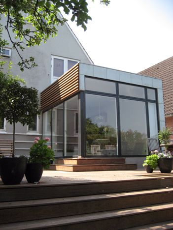 Moderne extension with timber cladding and zinc. Would use for one front window only.