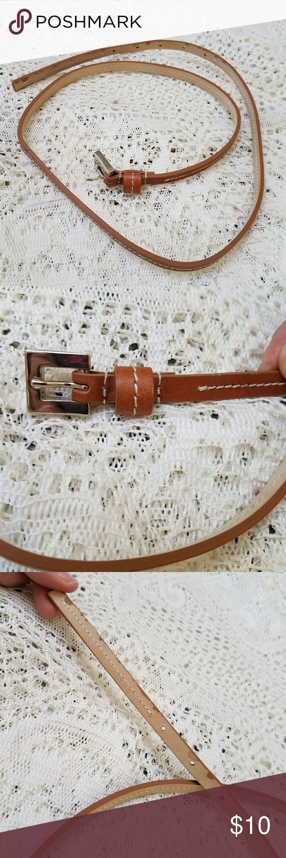 Unmarked Thin Tan Leather Belt Skinny little leather belt, tan with stitching as shown. Good condition. Measures 35 inches to last hole, and 3/8 inches wide. Silver tone buckle. Accessories Belts