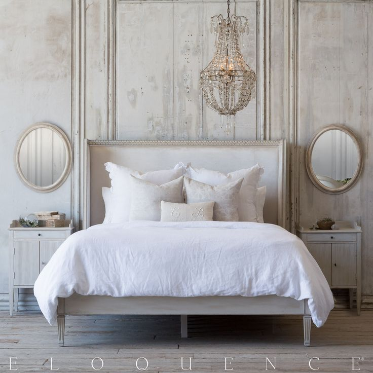 Eloquence® Cassia Bed in Antique Linen and Dove Velvet Eloquence® Cassia Queen Bed in lovely Antique Linen finish. A modern square back frame with romantic hand- carved details. Upholstered in luxurious Dove Velvet and resting on Gustavian inspired legs. Also available in King size