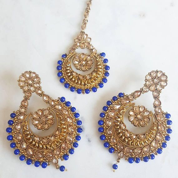 Check out this item in my Etsy shop https://www.etsy.com/ca/listing/553270694/royal-blue-antique-gold-earring-and