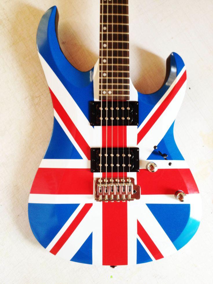 Guitarra en corte de vinil para (fridays)