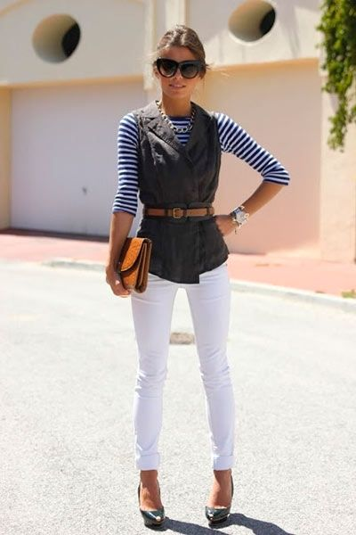 Placing a belt over a wrap or cardigan not only draws you in at the waist, but also brings the whole oufit together