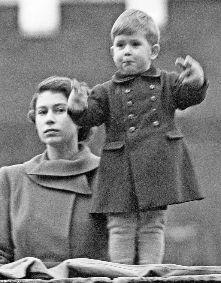 July 20, 2016 - Look, Mummy! An excited two-year-old Prince Charles, with the then Princess Elizabeth, watches a procession for Queen Juliana of the Netherlands in 1950. ~ Photo by Getty Images.