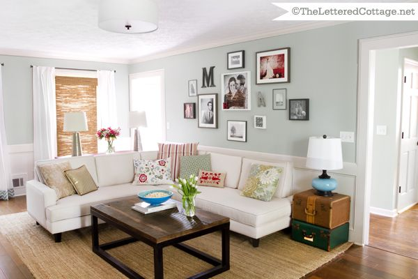 HGTV Room | The Lettered Cottage- absolutely LOVE this living room- love the blue/gray walls with neutral furniture with pops of red and green and turquoise.