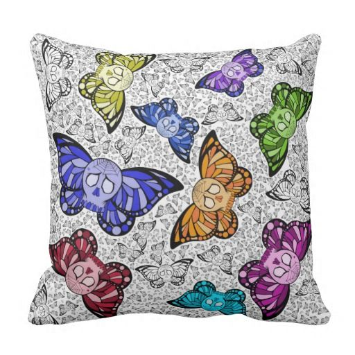 Butterfly Skulls Throw Pillow.  Artwork by Toni Lee from http://www.tearingcookie.com/  Design work by Mannzie.