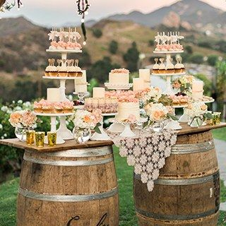 Think beyond the standard wedding cake stand! Whether it's a whimsical donut tower or tiers of bite-sized pie pops, a stylish bar of sweets is an easy way to impress your guests. Plus, it's a fun way to personalize your big day!